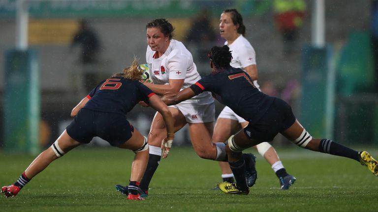 Amy Cokayne on the charge for England