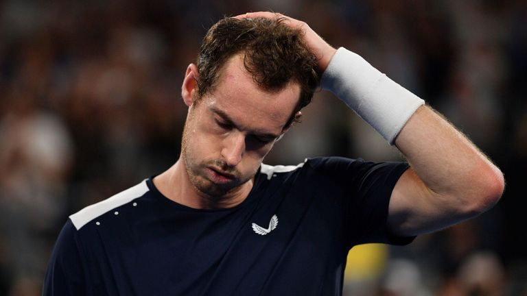 Andy Murray reacts after defeat in his men's singles match against Roberto Bautista Agut
