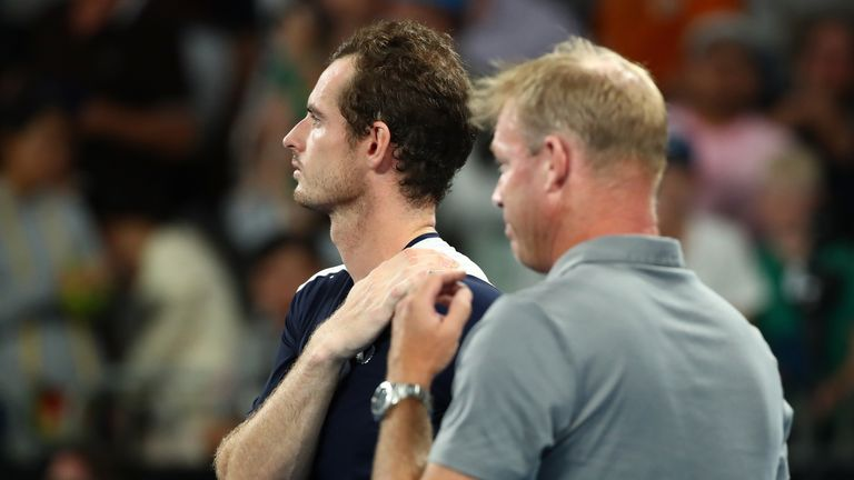Murray and his former coach Mark Petchey, who interviewed him post-match, watch on as a montage of tributes from fellow players is shown