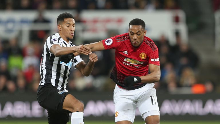 Manchester United's Anthony Martial in action with Isaac Hayden of Newcastle United
