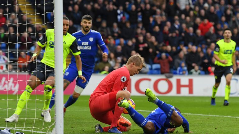Jonas Lossl saves at the feet of Junior Hoilett during a rare Cardiff attack on Saturday