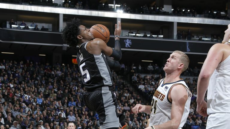 De'Aaron Fox of the Sacramento Kings drives to the basket against the Denver Nuggets