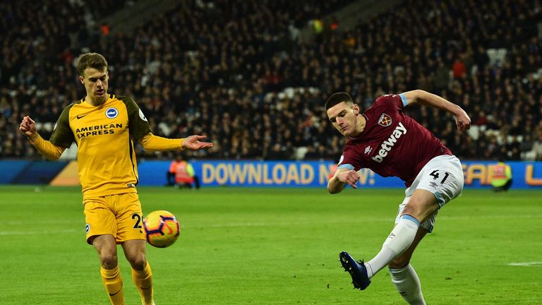 Declan Rice (R) clears the ball