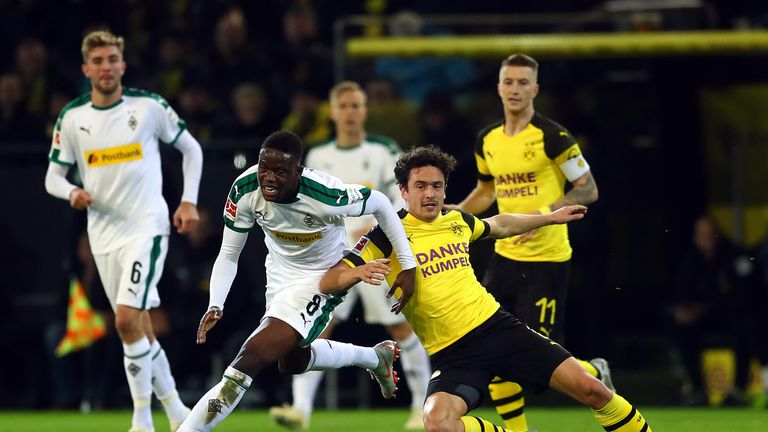 Denis Zakaria (left) of Borussia Monchengladbach is another name on Spurs' list
