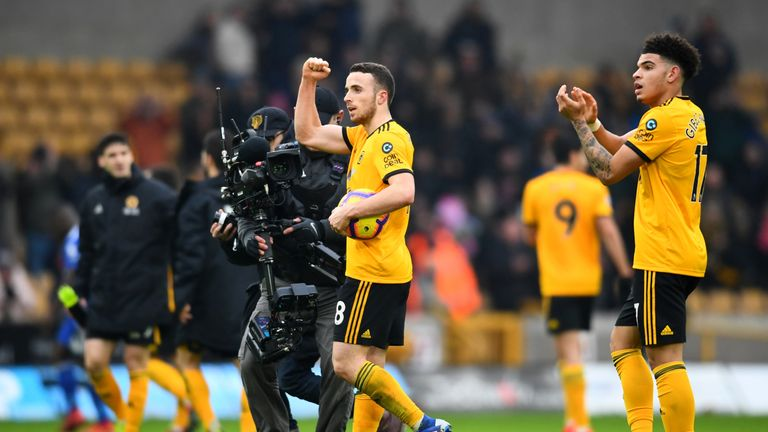 Diogo Jota celebrates with the match ball after his hat-trick secures a 4-3 win over Leicester City