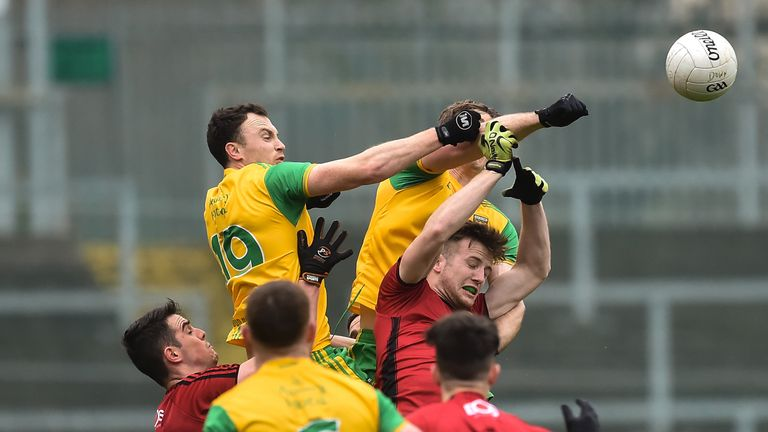 Spot the ball: Donegal and Down players compete for possession in the McKenna Cup