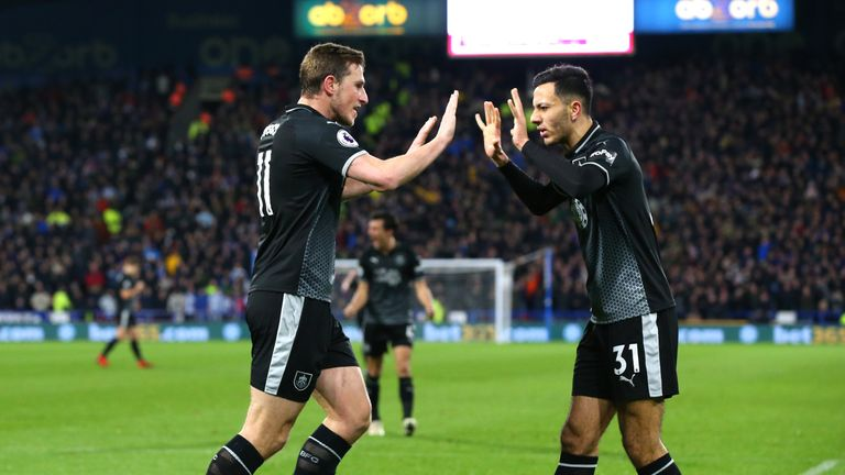 Dwight McNeil (R) celebrates after setting up Chris Wood's equaliser for Burnley