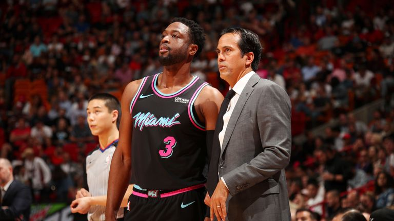 Dwyane Wade speaks with Miami Heat head coach Erik Spoelstra during the game against the Denver Nuggets