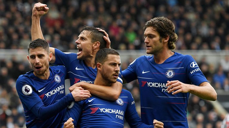 Eden Hazard of Chelsea celebrates with teammates after scoring a penalty for his team's first goal during the Premier League match between Newcastle United and Chelsea FC at St. James Park on August 26, 2018 in Newcastle upon Tyne, United Kingdom.