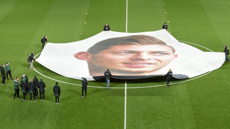 A banner showing Emiliano Sala's face is held at the centre circle ahead of kick-off at Nantes' Ligue 1 fixture with Saint-Etienne