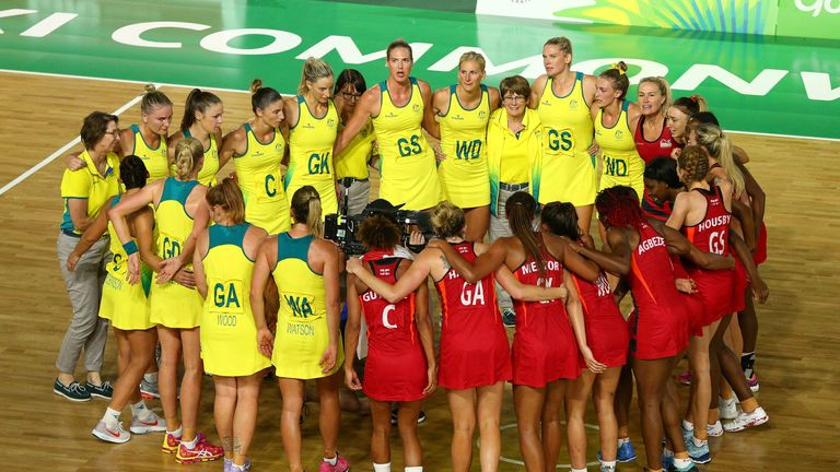 Australia and England huddled together after the full-time whistle of the Commonwealth Games' final im 2018