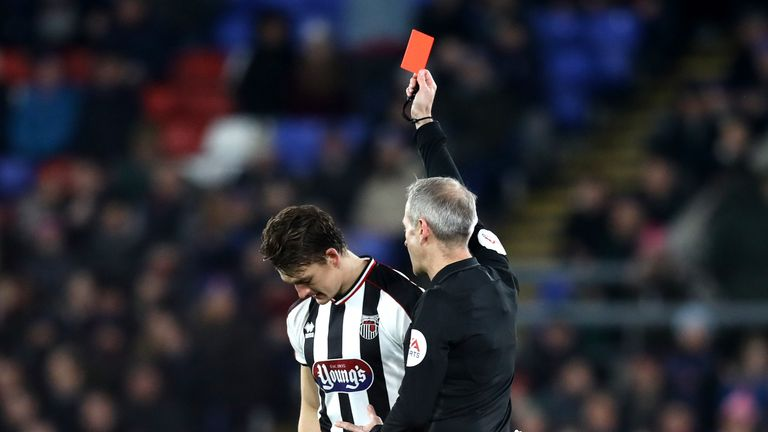 Martin Atkinson sent off Grimsby's Andy Fox in the second minute against Crystal Palace after consulting VAR