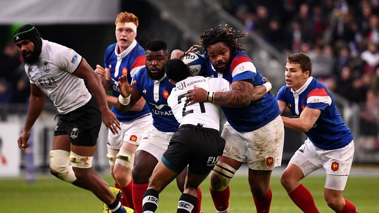 France's Mathieu Bastareaud is shackled by the Fiji defence during their clash at the Stade de France