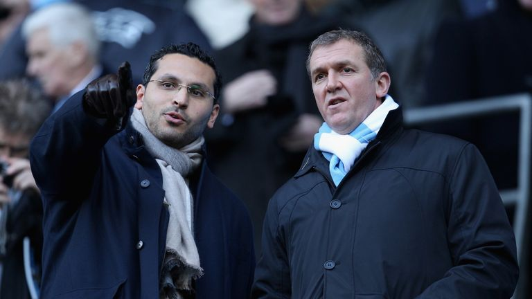 Cook alongside City chairman Khaldoon Al Mubarak