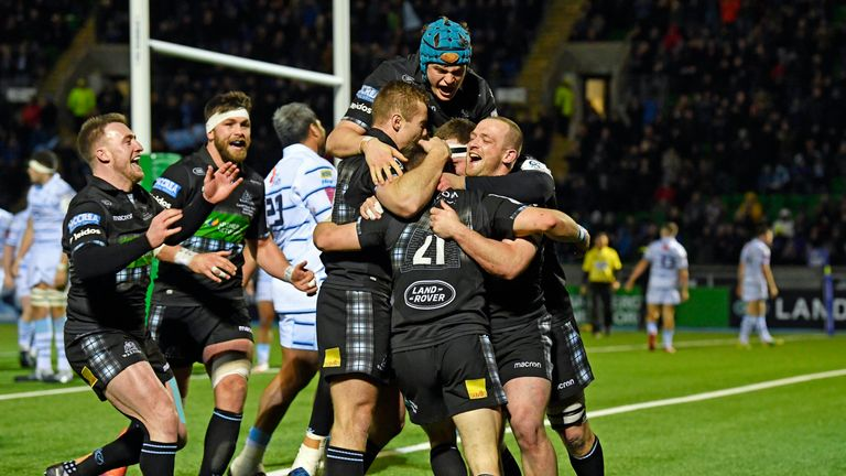 The Warriors celebrate George Horne's late score at Scotstoun