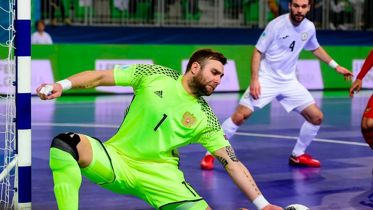 Russia's goalkeeper Georgi Zamtaradze goes for a save during the European Futsal Championship third place playoff match between Russia and Kazakhstan's at Arena Stozice in Ljubljana on February 10, 2018.