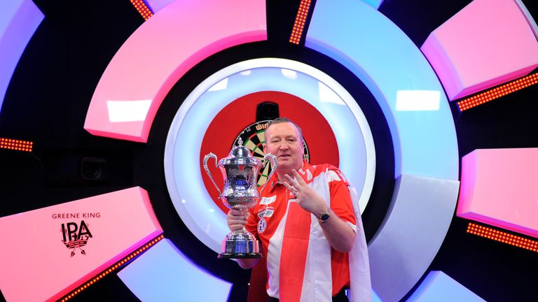 Glen Durrant celebrates a third successive BDO World Championship title