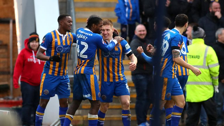 Greg Docherty of Shrewsbury Town celebrates with team-mates after scoring his team's first goal during the FA Cup Fourth Round match between Shrewsbury Town and Wolverhampton Wanderers at New Meadow on January 26, 2019 in Shrewsbury, United Kingdom