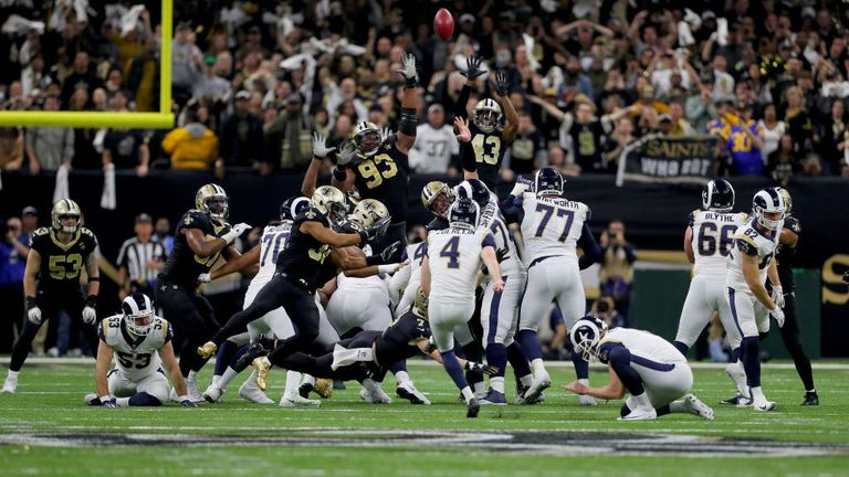 Greg Zuerlein of the Los Angeles Rams kicks a field goal to tie the game and send it to overtime against the New Orleans Saints during the fourth quarter in the NFC Championship