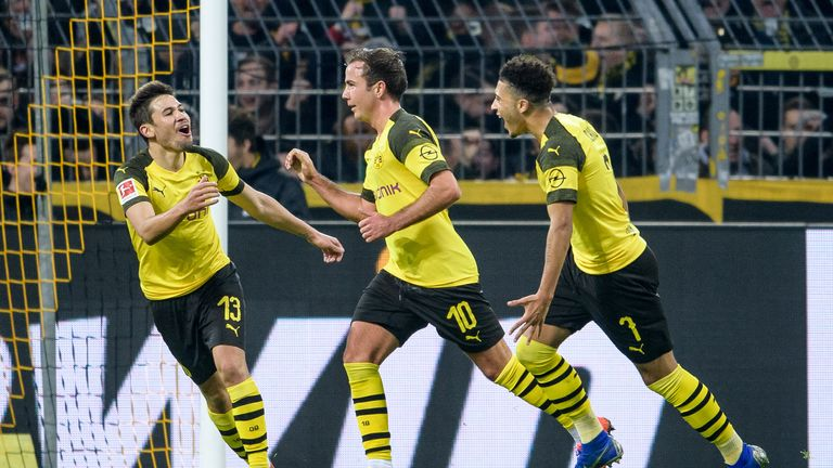 Raphael Guerreiro (left) celebrates his goal with Mario Gotze and Jadon Sancho