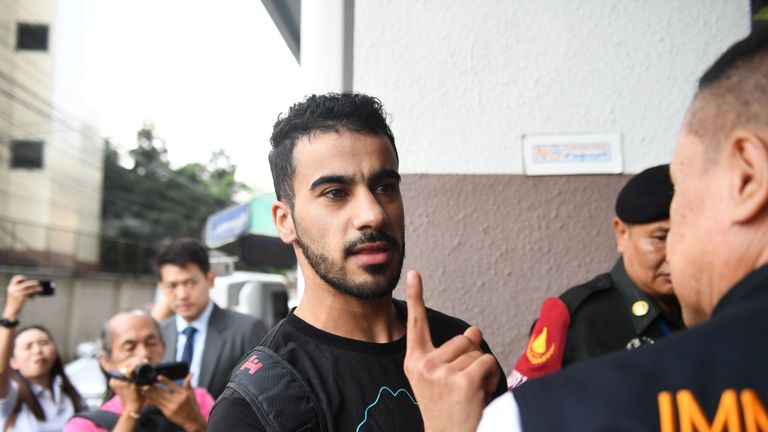 Hakeem al-Araibi a former Bahrain national team footballer with refugee status in Australia, is escorted by immigration police to a court in Bangkok