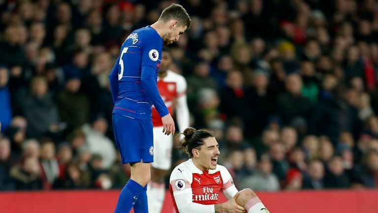 Hector Bellerin reacts after picking up an injury in the game against Chelsea