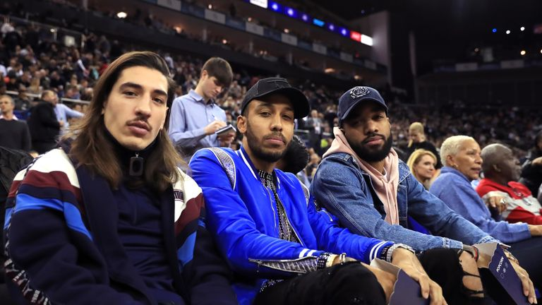 (From left to right) Hector Bellerin, Pierre-Emerick Aubameyang and Alexandre Lacazette in the crowd during the NBA London Game 2019 at the O2 Arena, London