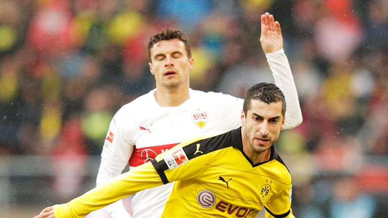 Heise challenges Henrikh Mkhitaryan during his time at Stuttgart