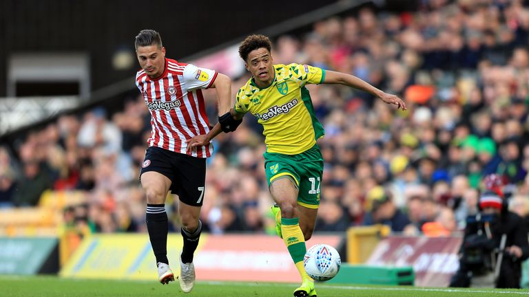 Jamal Lewis (R) in action for Norwich
