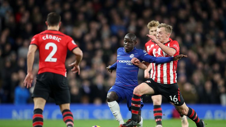 N'Golo Kante and James Ward-Prowse compete for the ball