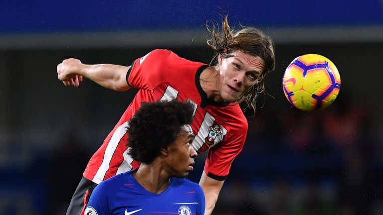 Jannik Vestergaard gets above Willian to head clear