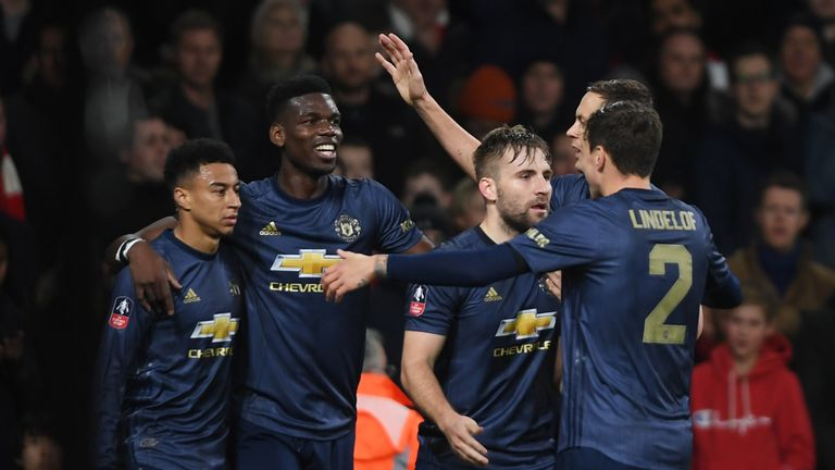 Jesse Lingard of Manchester United (R) celebrates with Paul Pogba and team-mates as he scores his team's second goal during the FA Cup Fourth Round match between Arsenal and Manchester United at Emirates Stadium on January 25, 2019 in London, United Kingdom.