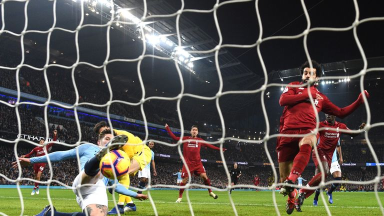 John Stones makes a goal-line clearance with Mohamed Salah closing in