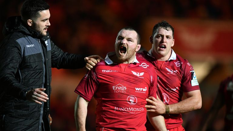 Ken Owens celebrates after scoring Scarlets' second try against Leicester