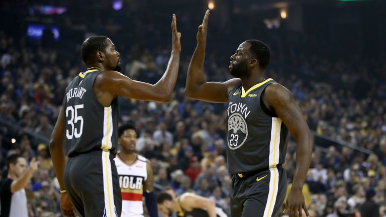 Kevin Durant high fives Draymond Green during their game against the New Orleans Pelicans