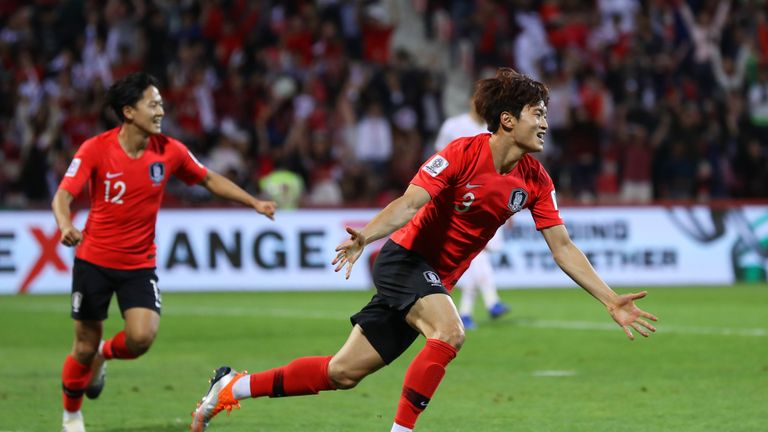 Jin-Su Kim celebrates scoring for South Korea