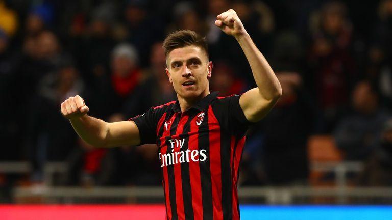 Krzysztof Piatek celebrates his double on his first start for Milan