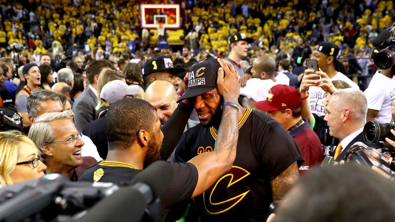 LeBron James #23 and Kyrie Irving #2 of the Cleveland Cavaliers celebrate after defeating the Golden State Warriors 93-89 in Game 7 of the 2016 NBA Finals at ORACLE Arena on June 19, 2016 in Oakland, California.