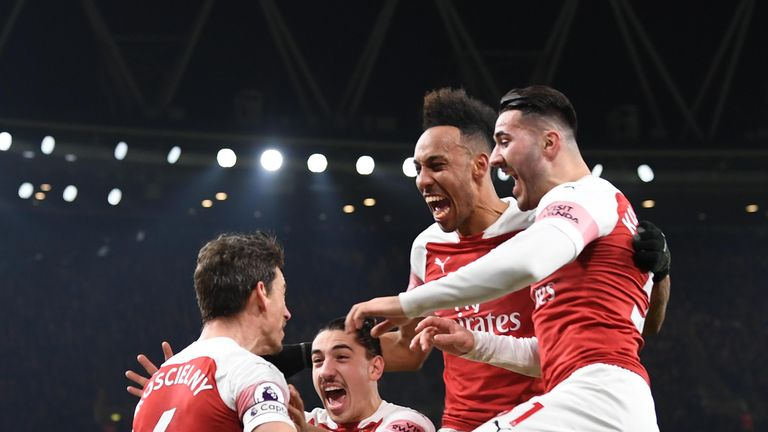 Arsenal moved within three points of Chelsea at the top of the table