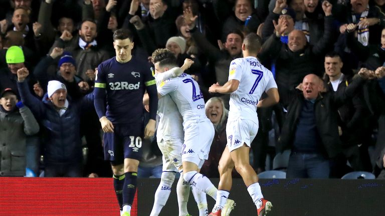 Leeds United's Jack Harrison (centre) celebrates scoring his side's second goal of the game with his team mates as Derby County's Tom Lawrence appears dejected during the Sky Bet Championship match at Elland Road, Leeds.