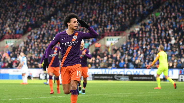 Leroy Sane of Manchester City celebrates after he scores his sides third goal during the Premier League match between Huddersfield Town and Manchester City at John Smith's Stadium on January 20, 2019 in Huddersfield, United Kingdom