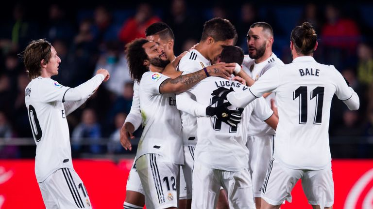 Madrid players celebrate Benzema's equaliser