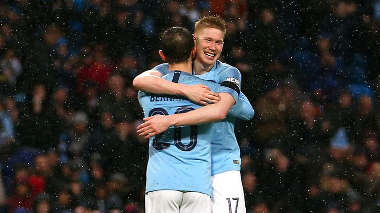 Manchester City's Bernardo Silva (centre left) celebrates scoring his side's second goal of the game with Kevin De Bruyne during the FA Cup fourth round match at Etihad Stadium, Manchester.