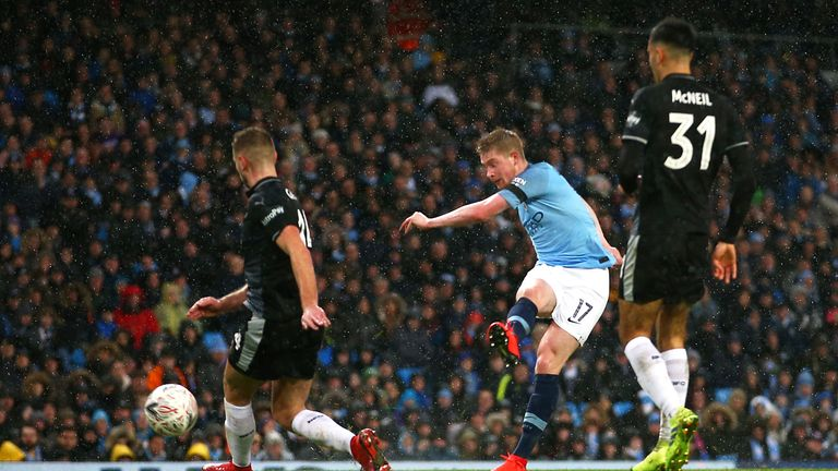 Manchester City's Kevin De Bruyne (centre) scores his side's third goal of the game during the FA Cup fourth round match at Etihad Stadium