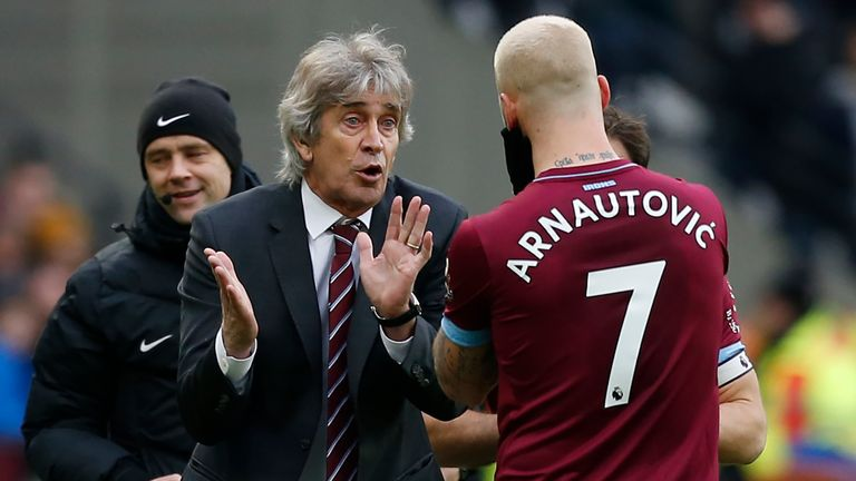 Manuel Pellegrini speaks with Marko Arnautovic during a break in play