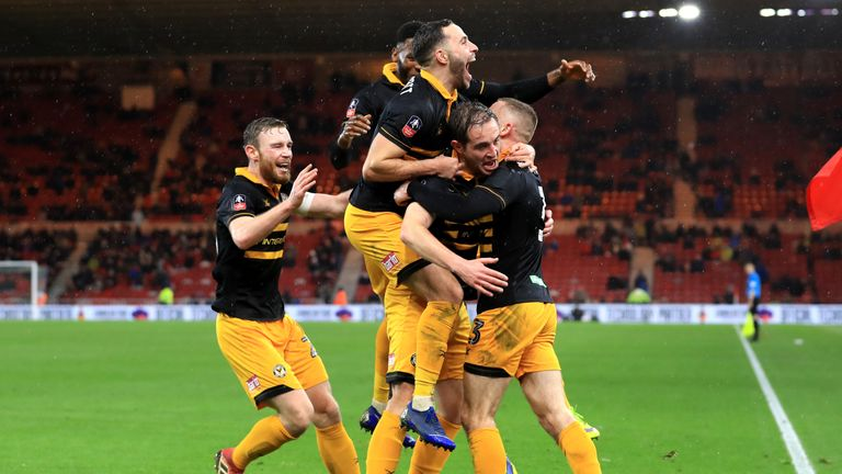 Matthew Dolan of Newport County celebrates with teammates after scoring his team's first goal during the FA Cup Fourth Round match between Middlesbrough and Newport County AFC at Riverside Stadium on January 26, 2019 in Middlesbrough, United Kingdom