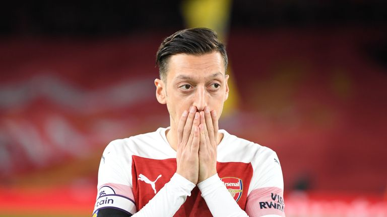 Mesut Ozil stands on the pitch following Arsenal's 1-1 draw with Liverpool in Novermber 2018.