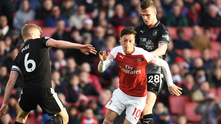 Mesut Ozil takes on Ben Mee during the Premier League match between Arsenal and Burnley at the Emirates Stadium on December 22, 2018