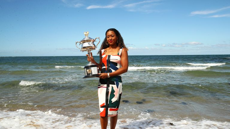 Naomi Osaka poses with the Daphne Akhurst Memorial Cup on Brighton Beach in Melbourne. Image: Sky Sports