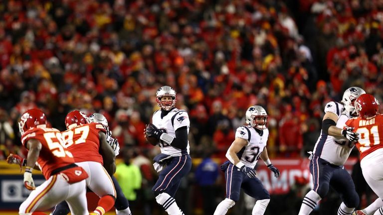 Tom Brady of the New England Patriots looks to pass in the first half against the Kansas City Chiefs during the AFC Championship Game